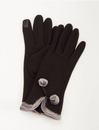 Knit gloves with faux fur trim and pom poms by Saki